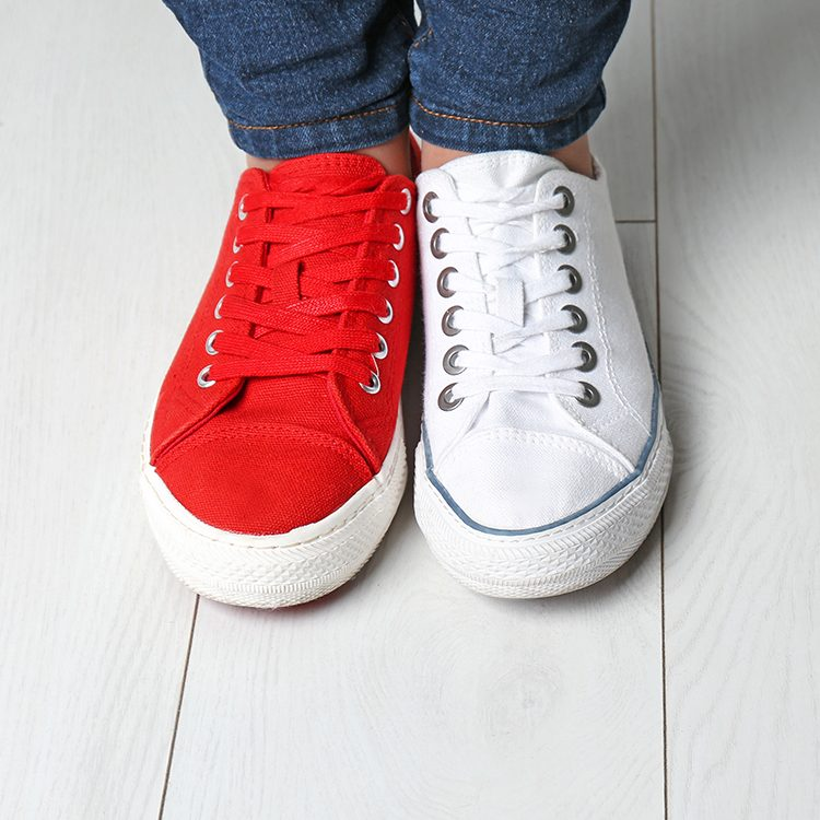 Canvas sneakers left shoe is red, right show is white